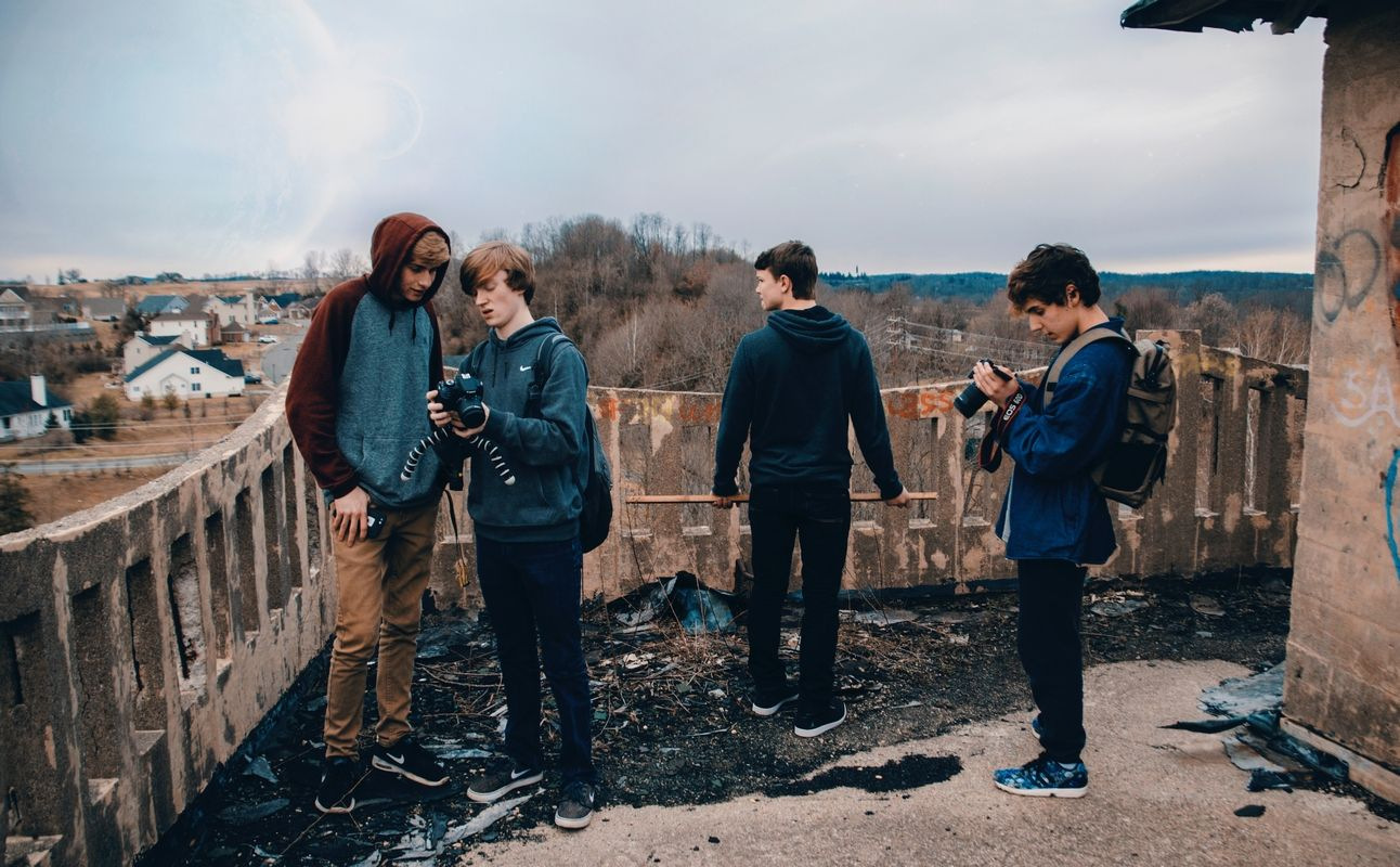 A group of teenagers exploring photography