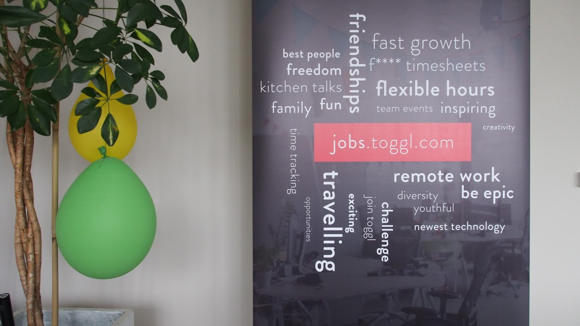 A Toggl Track banner in the Toggl Track office