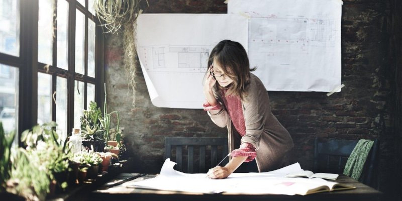 Woman working in office while on the phone