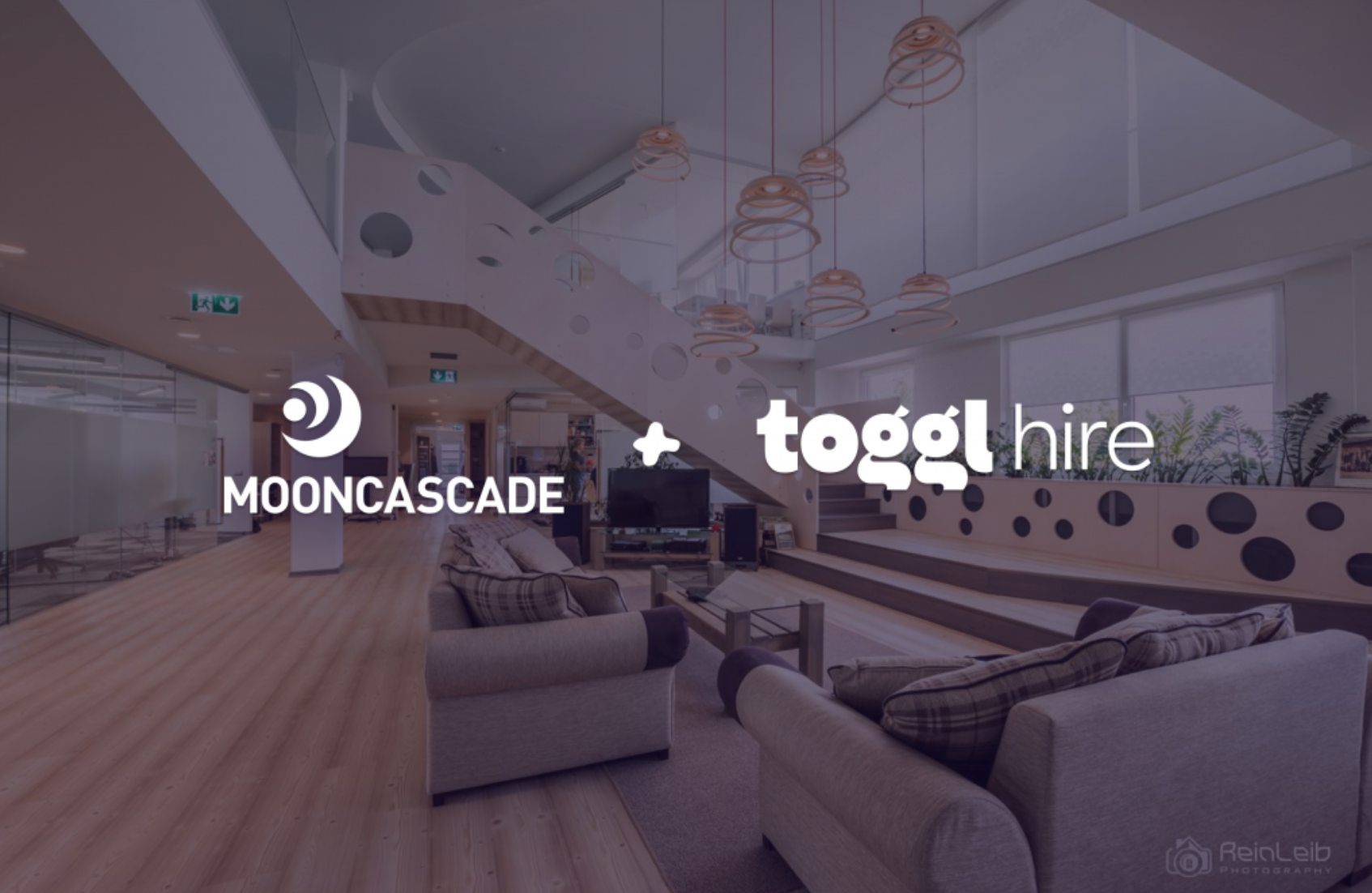 Mooncascade and toggl hire logos overlayed on image of big lounge
