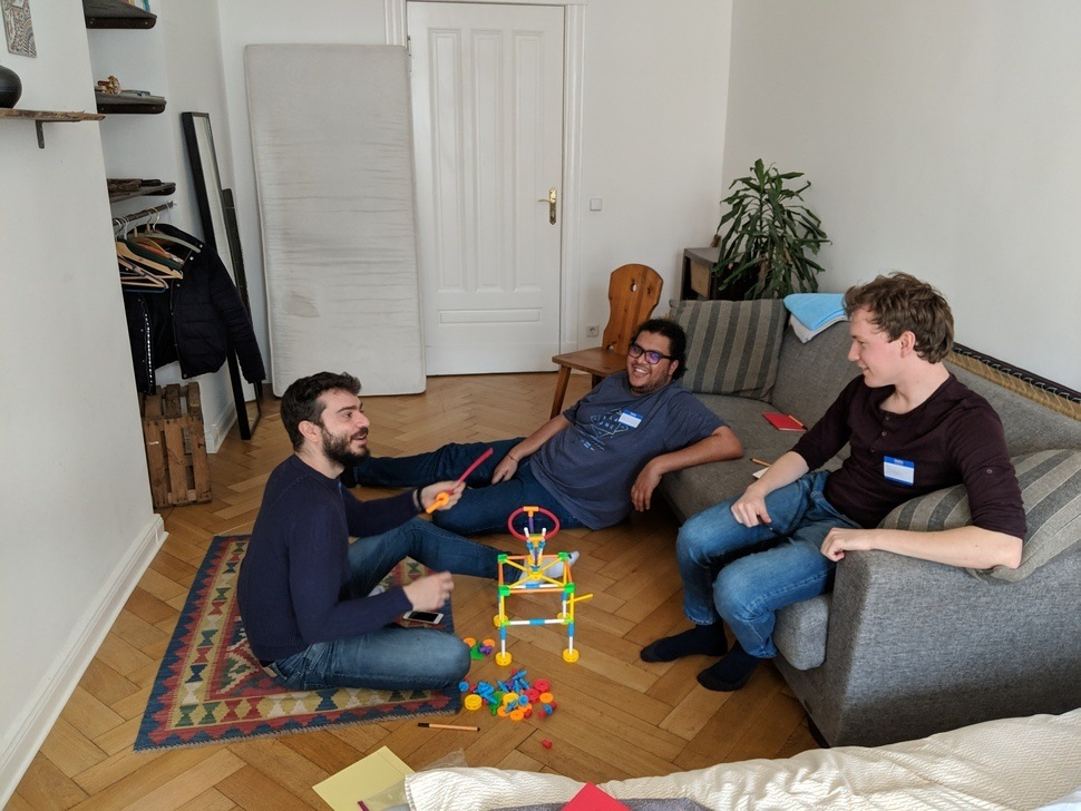 3 people chilling out in a living room