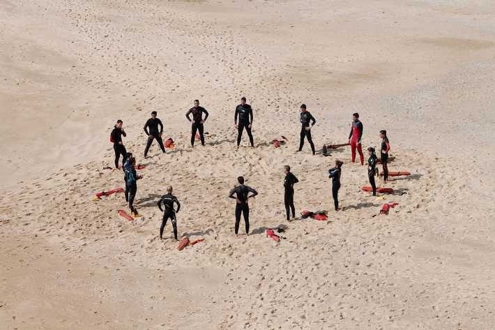 Photo of a group of bodyguards at the beach